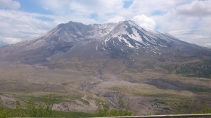 Mount St Helen's, with the results of its explosion - the side of the mountain gone, the valley full of mud and ash, the river almost entirely swallowed.